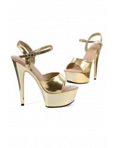 1 Sandales à semelle plateforme. Empeigne et boucle en simili-cuir doré. Semelle en vinyle chromé. Sem