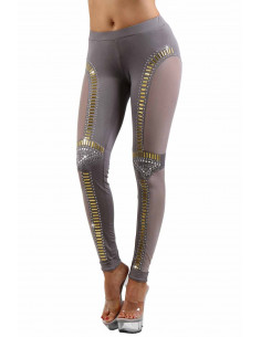 1 Legging stretch, empiècements coté en tulle. Finitions rivets dorés et argentés