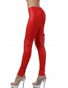 1 Pantalon slim taille basse. Ceinture élastique. Laçage derrière